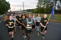 Capt. Kekura Maran, assigned to the 1-222d Aviation Regiment, leads his company during the Army Reserve's 109th Birthday Celebration run on Joint Base-Langley, Virginia 21 April 2017.