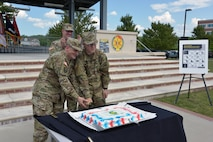 Maj. Gen. Paul M. Benenati, the Deputy Chief of Staff for the U.S. Army Training and Doctrine Command (TRADOC), and Pvt. Colton R. Humphries, assigned to the 417th Transportation Detachment, Baltimore, Maryland, cut the cake to commemorate the Army Reserve's 109th Birthday on Joint Base-Langley, Virginia 21 April 2017. Benenati and Humphries represent the oldest and youngest Soldiers at the celebration.
