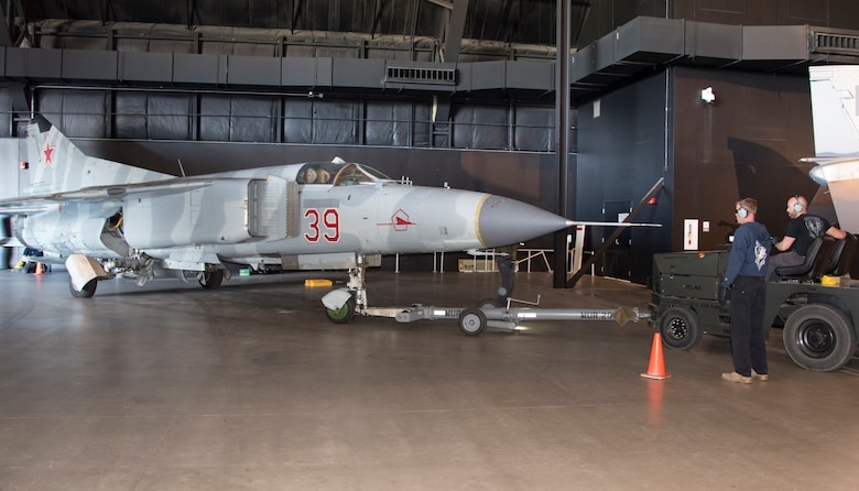 "DAYTON, Ohio -- The Mikoyan-Gurevich MiG-23MS ""Flogger-E"" being moved into the museum's Cold War Gallery on April 25, 2017. (U.S. Air Force photo by Ken LaRock)"