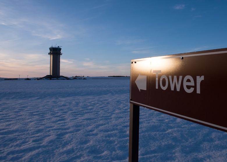 The base air traffic contol tower stands above the flightline Feb. 8, 2017 at Fairchild Air Force Base, Washington. The tower is positioned to give a complete view of the airfield and to give an unobstructed view of all incoming flights. (U.S. Air photo/Airman 1st Class Ryan Lackey)