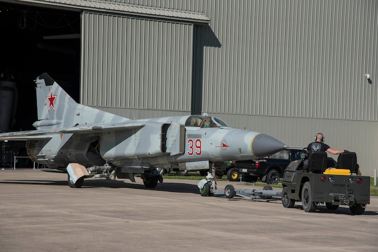 """DAYTON, Ohio -- The Mikoyan-Gurevich MiG-23MS """"Flogger-E"""" being moved into the museum's Cold War Gallery on April 25, 2017. (U.S. Air Force photo by Ken LaRock)"""