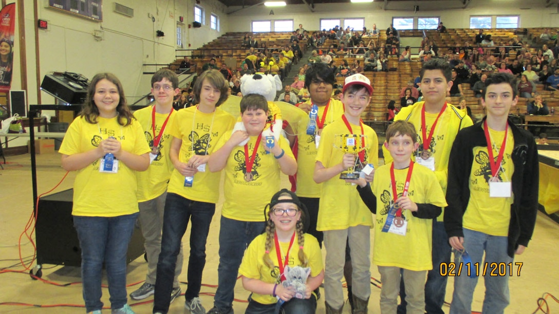 Team Legotronics from Harris Middle School in Shelbyville receive a first place LEGO® trophy at the East Tennessee FIRST® LEGO® League Championships held at Tennessee Tech University in February. The students placed for their presentation of their Animal Allies project. (Photo submitted)