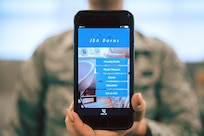 The Joint Base Andrews Dorm Mobile Application is displayed on a phone at JBA, Md., April 25, 2017. The app, which is free and currently available for download from either the Apple App Store or the Google Play Store, provides up-to-date dorm event calendar, the unaccompanied housing guide, a newsletter and an option for repair request. (U.S. Air Force photo by Senior Airman Delano Scott)