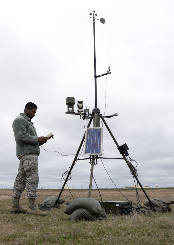 Airman 1st Class Errol Petgrave, 5th Operations Support Squadron weather forecaster, inspects the Deployed Tactical Meteorological Observing System for damage at Minot Air Force Base, N.D., April 18, 2017. Petgrave is checking the statistics and the raw data from the TMQ-53, which afterwards sends the data to their computer. (U.S. Air Force photos/Airman 1st Class Dillon Audit)