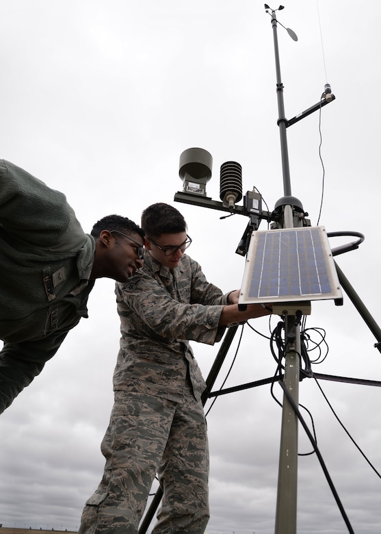 (From left) Airman 1st Class Errol Petgrave and Airman Connor McDonald, 5th Operations Support Squadron weather forecasters, inspect a Deployed Tactical Meteorological Observing System (TMQ-53) at Minot Air Force Base, N.D., April 18, 2017. The TMQ-53 gathers atmospheric data and is used mostly in deployed locations. (U.S. Air Force photos/Airman 1st Class Dillon Audit)