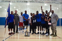 The 2nd Security Forces Squadron basketball team poses with their trophy after defeating the 2nd Force Support Squadron basketball team in two games at Barksdale Air Force Base, La., April 18, 2016. The Defenders won game two 46-39 to clinch the title. (Air Force photo/Airman 1st Class Stuart Bright)