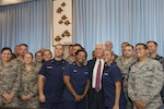 "Vice President Mike Pence poses for a photo with U.S. service members stationed on the island of Oahu, Hawaii, April 24, 2017. Pence stopped in Hawaii to thank service members for ""answering the call to serve our country,"" marking the end of a 10-day trip to Asia. Air Force photo by Master Sgt. Raquel Griffin"