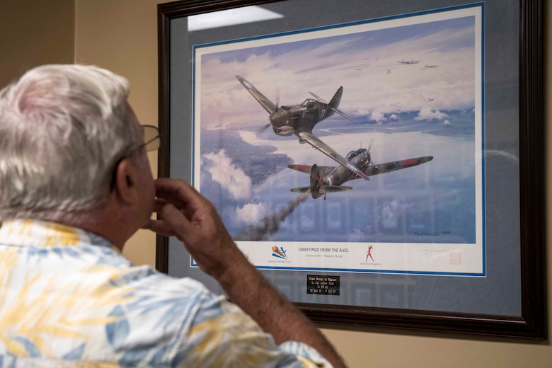 A veteran marvels at a photo on display during a tour of the 74th Fighter Squadron during a reunion, April 24 to 26, at Moody Air Force Base, Ga. The veterans were all stationed at Moody in the late 1970s. Many fought alongside one another during the Vietnam War in support of the F-4E Phantom II's mission (U.S. Air Force Photo by Airman 1st Class Janiqua P. Robinson)