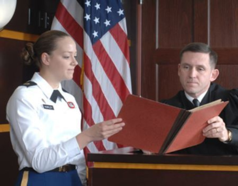 In 2012, Staff Sgt. Sarah Hawley, a paralegal noncommissioned officer with the U.S. Army Reserve Legal Command worked at the court at Fort Bragg, NC. She is pictured here with a military judge is Lt. Col. Bret Batdorff. (photo/contributed)