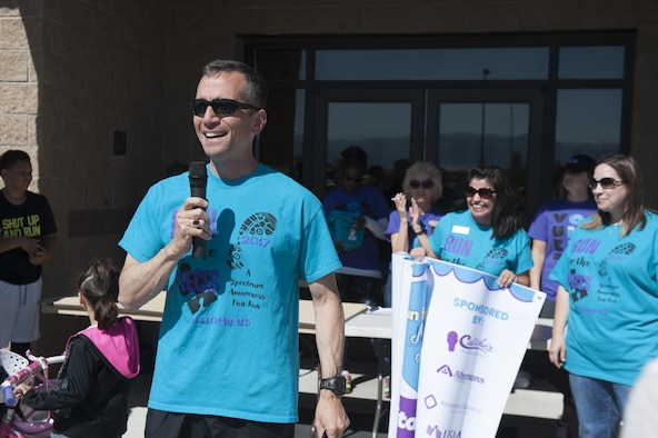Col. Houston Cantwell, the 49th Wing commander, welcomes family and friends to the Military Children's Carnival on April 22, 2017 at Holloman Air Force Base, N.M. The carnival followed the Run for the Pieces, a fun run and walk that aimed to raise awareness for children that are on the autism spectrum. (U.S. Air Force photo by Airman 1st Class Ilyana A. Escalona)