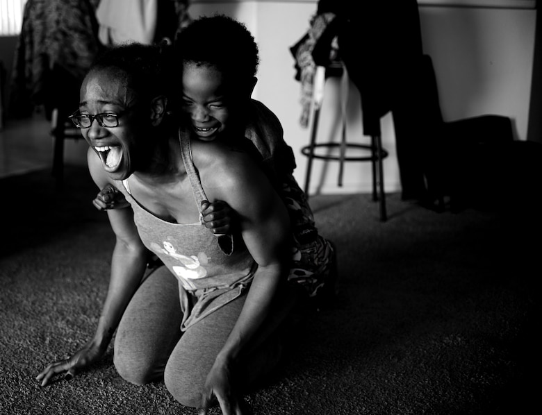 Semaj, 432nd Aircraft Maintenance Squadron supply craftsman, and her son Jamel, 6, play together April 2, 2017, at their home in Las Vegas. Semaj is able to compete successfully in women's bodybuilding as a nationally qualified amateur while being a single mother. (U.S. Air Force photo/Senior Airman Christian Clausen)