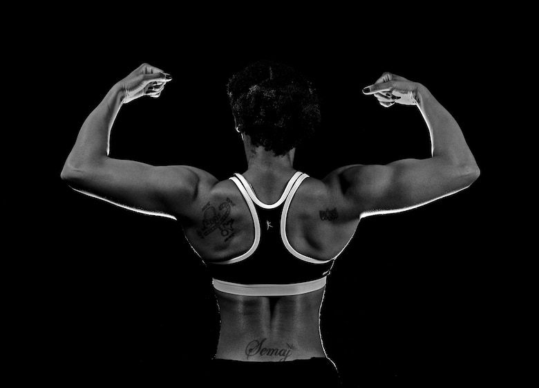 Staff Sgt. Semaj, 432nd Aircraft Maintenance Squadron supply craftsman, displays her back pose March 27, 2017, at Creech Air Force Base, Nev. Semaj is a nationally qualified amateur bodybuilder competing in the figure category. (U.S. Air Force photo/Senior Airman Christian Clausen)