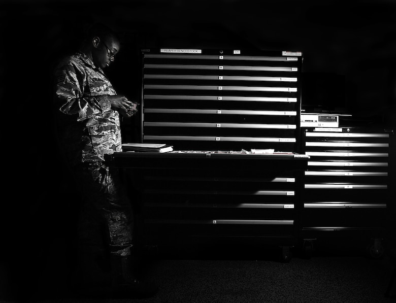 Staff Sgt. Semaj, 432nd Aircraft Maintenance Squadron supply craftsman, completes a drawer check March 27, 2017, at Creech Air Force Base, Nev. Semaj is responsible for ordering and ensuring parts availability for MQ-1 Predators and MQ-9 Reapers. (U.S. Air Force photo/Senior Airman Christian Clausen)