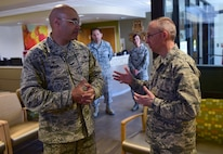 Col. David Miller, Jr., 460th Space Wing commander, speaks with Brig. Gen. James Burks, Director, Manpower, Personnel, and Resources Corps Chief, Medical Service Corps, April 25, 2017, on Buckley Air Force Base, Colo. Burks toured the medical facilities on base and was briefed the status of each unit. (U.S. Air Force photo by Airman Jacob Deatherage/Released)