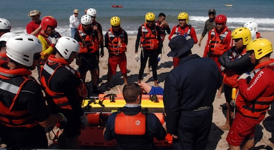 U.S. Public Health Service Cmdr. Kiel Fisher and first responders from the Mexican states of Jalisco and Michoacán review various techniques using a rescue sled to save a water-based victim in Puerto Vallarta, Mexico, March 22, 2017. U.S. Northern Command donated $270,000 of equipment and sent multiple representatives to Puerto Vallarta for a week of water search and rescue training with Mexican firefighters and lifeguards. This training took place in support of Northcom's humanitarian assistance partnership with the Mexican government. Northcom photo by Air Force 1st Lt. Lauren Hill