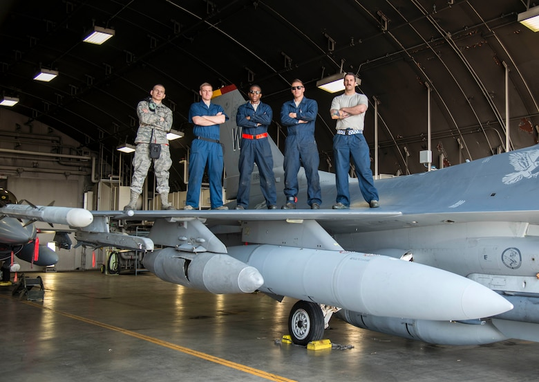 Airmen with the 13th Aircraft Maintenance Squadron pose for a photo on top of an F-16 Fighting Falcon at Misawa Air Base, Japan, April 20, 2017. The 13th AMXS worked tirelessly to ensure all the 13th Fighter Squadron's jets are 100 percent mission capable. (U.S. Air Force photo by Senior Airman Brittany A. Chase)