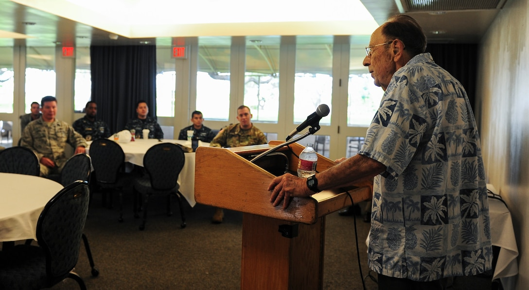 Retired U.S. Navy Capt. John Woolston, survivor of the USS Indianapolis, shares his story with members from the Defense Information Systems Agency Pacific (DISA PAC) at the Wright Brother's Café on Hickam, April 21, 2017.  The service members held the breakfast to learn about leadership lessons from Woolston's experiences.   (U.S. Air Force photo by Tech. Sgt. Heather Redman)