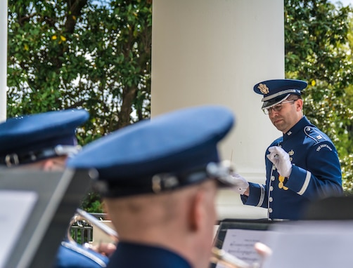 Captain Boothe conducts the Ceremonial Brass at the 2017 Spring White House Garden  Tour. (U.S. Air Force photos/MSgt Brandon Chaney/released)