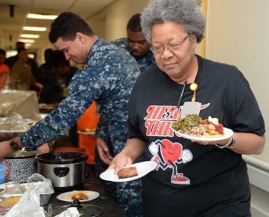 """Naval Branch Health Clinic-Albany Sailors and civilian personnel prepare a feast to commemorate African-American heritage in a celebration at Marine Corps Logistics Base Albany, recently. The event, which began at the clinic, ended at the Base Theater, with a private showing of the movie, """"Hidden Figures."""""""