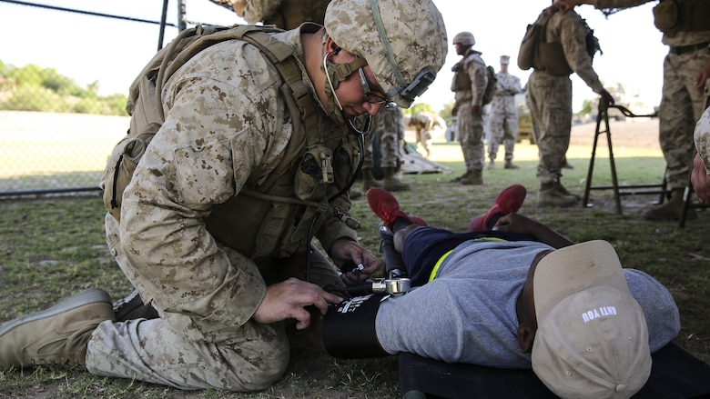 A role player seeks medical attention during Assault Support Tactics 3, supporting Marine Aviation Weapons and Tactics Squadron during the semiannual Weapons and Tactics Instructor Course 2-17 at Marine Corps Air Station Yuma, Arizona, April 21. Lasting seven weeks, WTI is a training evolution hosted by MAWTS-1 which provides standardized advanced and tactical training and certification of unit instructor qualifications to support Marine aviation training and readiness. The AST-3 training focused on conducting noncombatant evacuation operations in an urban environment while providing foreign humanitarian assistance to the simulated host nation.