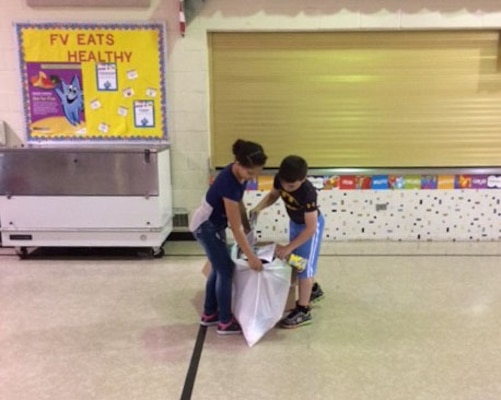 Students participate in a recycling race.