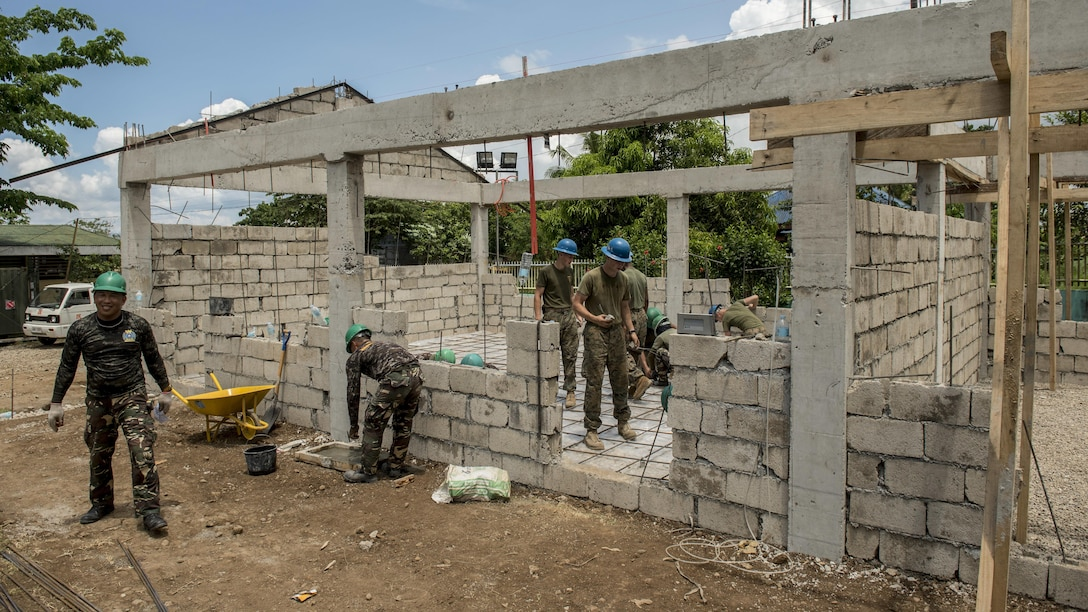 Philippine soldiers and U.S. military engineers prepare a structure for concrete pouring during Balikatan 2017 in Ormoc, Leyte, April 23, 2017. Armed Forces of the Philippines and U.S. military engineers worked together to build a new classroom at Don Carlos Elementary School in Ormoc. Balikatan is an annual U.S.-Philippine military bilateral exercise focused on a variety of missions, including humanitarian assistance and disaster relief and counterterrorism. (U.S. Air Force photo by Staff Sgt. Peter Reft)