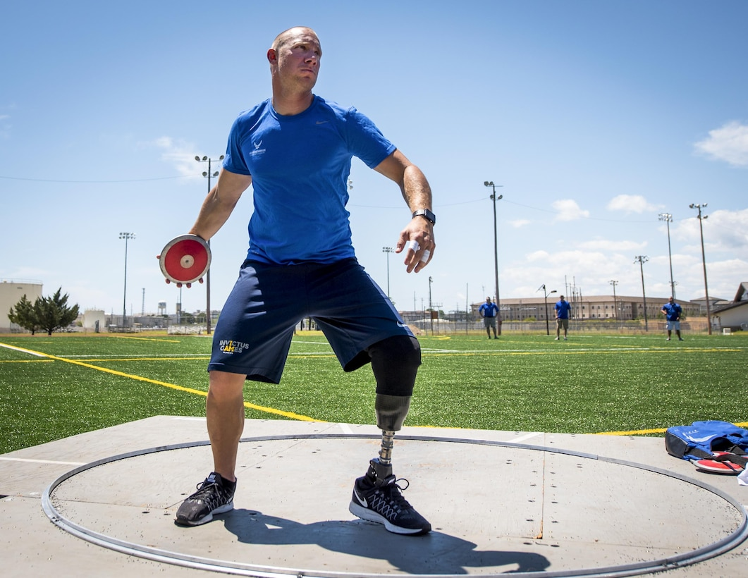 Ben Seekell, a Warrior Games athlete, begins his discus rotation during a track and field session at the Air Force team's training camp at Eglin Air Force Base, Fla., April 25. The base-hosted, week-long Warrior Games training camp is the last team practice session before the yearly competition in June. (U.S. Air Force photo/Samuel King Jr.)