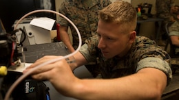 Lance Cpl. Vincent A. Smyth, Marine Air-Ground Task Force planning specialist with the Command Element, Special Purpose Marine Air-Ground Task Force - Southern Command, calibrates a three-dimensional printer during the 3-D Printing Training Course at Marine Corps Base Camp Lejeune, North Carolina, April 20, 2017. Marines from various sections of SPMAGTF-SC attended the two-day training hosted by General Support Maintenance Company, 2nd Maintenance Battalion, Combat Logistics Regiment 25, 2nd Marine Logistics Group, in order to gain hands-on experience with 3-D printers and receive instruction in computer-aided design, file creation and manufacturing.