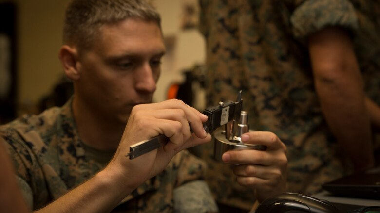 Sgt. Chris P. Tellef, a fire team leader with the Logistics Combat Element, Special Purpose Marine Air-Ground Task Force - Southern Command, measures a water jet nozzle during the 3-D Printing Training Course at Marine Corps Base Camp Lejeune, North Carolina, April 20, 2017. Marines from various sections of SPMAGTF-SC attended the two-day training hosted by General Support Maintenance Company, 2nd Maintenance Battalion, Combat Logistics Regiment 25, 2nd Marine Logistics Group, in order to gain hands-on experience with 3-D printers and receive instruction in computer-aided design, file creation and manufacturing.
