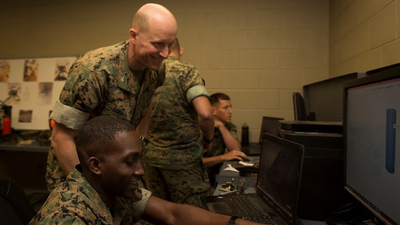 Col. Michael V. Samarov, commander of Special Purpose Marine Air-Ground Task Force - Southern Command, watches Lance Cpl. Eric C. Mitts, a water support technician with the Logistics Combat Element, SPMAGTF-SC, create a computer-aided design during the Three-dimensional Printing Training Course at Marine Corps Base Camp Lejeune, North Carolina, April 20, 2017. Marines from various sections of SPMAGTF-SC attended the two-day training hosted by General Support Maintenance Company, 2nd Maintenance Battalion, Combat Logistics Regiment 25, 2nd Marine Logistics Group, in order to gain hands-on experience with 3D printers and receive instruction in computer-aided design, file creation and manufacturing.