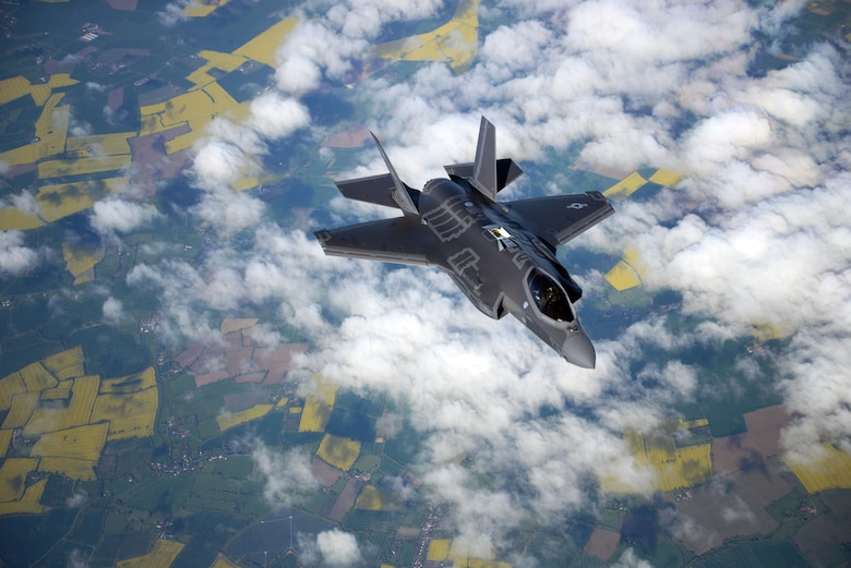 A U.S. Air Force F-35 Lightning II from Hill Air Force Base, Utah, flys alongside a 100th Air Refueling Wing KC-135 Stratotanker during a flight to Estonia on April 25, 2017. The F-35's are participating in their first-ever flying training deployment to Europe. (U.S. Air Force photo by Senior Airman Christine Groening)