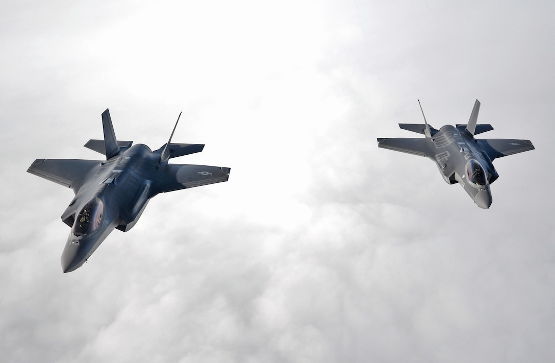 U.S. Air Force F-35 Lightning II's from Hill Air Force Base, Utah, flys alongside a 100th Air Refueling Wing KC-135 Stratotanker in formation during a flight to RAF Lakenheath April 25, 2017. The F-35's are participating in their first-ever flying training deployment to Europe. (U.S. Air Force photo by Senior Airman Christine Groening)