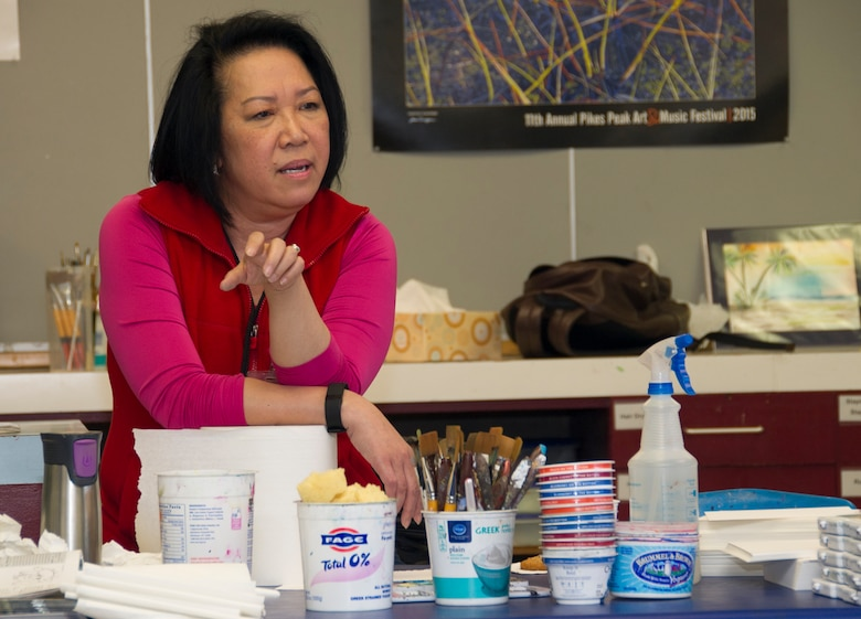 SCHRIEVER AIR FORCE BASE, Colo. -- Kim le Nguyen explains her artistic process to members of the 310th Operations Support Squadron during a course at the Bemis School of Art in Colorado Springs on Friday, Apr. 21st, 2017. Nguyen teaches a Military Artistic Healing program at the Colorado Springs Fine Arts Center, using all forms of art to encourage healing among military members and their families.  (U.S. Air Force photo/Senior Airman Laura Turner)