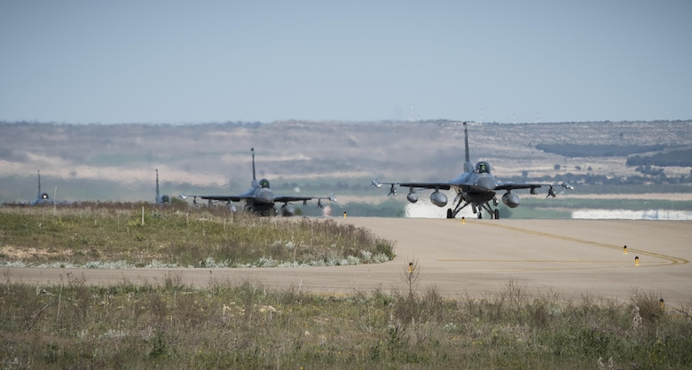 F-16 Fighting Falcons from Hill Air Force Base, Utah, taxi down the runway April 21, 2017, at Albacete Air Base, Spain, to participate in the Tactical Leadership Programme. TLP is an annual NATO Mission Commander's School training program designed to provide joint tactical training with NATO allies to increase NATO coordination and strengthen combined air operations. This type of training is an opportunity for Hill's active duty and Reserve Airmen to hone their operational and tactical leadership skills with allied air forces. (U.S. Air Force photo/Senior Airman Justin Fuchs)