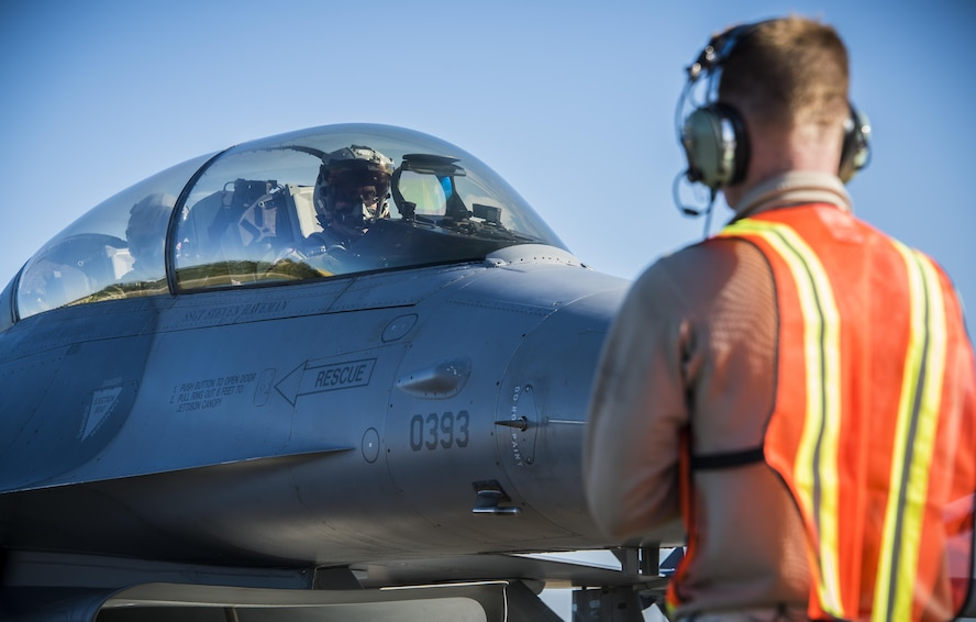 "Airman 1st Class Drew Snider, a crew chief from the 388th Maintenance Squadron at Hill Air Force Base, Utah, guides Capt. Jeff ""Strobe"" Whitford, a pilot from the 421st Fighter Squadron, to park his F-16 Fighting Falcon April 21, 2017, on Albacete Air Base, Spain. This is the first time the 419th and 388th Fighter Wings from Hill Air Force Base, Utah, are participating in the Tactical Leadership Program. TLP is an annual NATO Mission Commander's School training program designed to provide joint training to increase NATO coordination and ensure stability in the region. (U.S. Air Force photo/Senior Airman Justin Fuchs)"