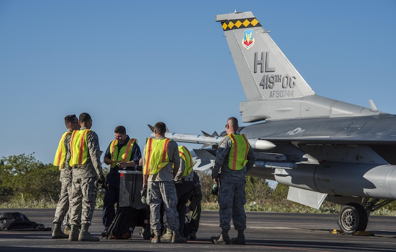 "U.S. Airmen from Hill Air Force Base, Utah, prepare to ""put a jet to bed"" April 21, 2017, at Albacete Air Base, Spain, after flying more than seven hours from the U.S. to participate in the Tactical Leadership Programme. Training courses like TLP help to enable the NATO alliance by providing an opportunity to work alongside NATO allies in the classroom and in European airspace. (U.S. Air Force photo/Senior Airman Justin Fuchs)"