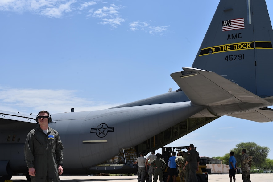 U.S. Air Force Staff Sgt. Zachariah Main, 19th Security Forces Fly Away Security Team (FAST) member, secures a C-130J assigned to Little Rock Air Force Base, Ark., April 16, 2017, in Lima, Peru. (U.S. Air Force photo by Staff Sgt. Jael Laborn)