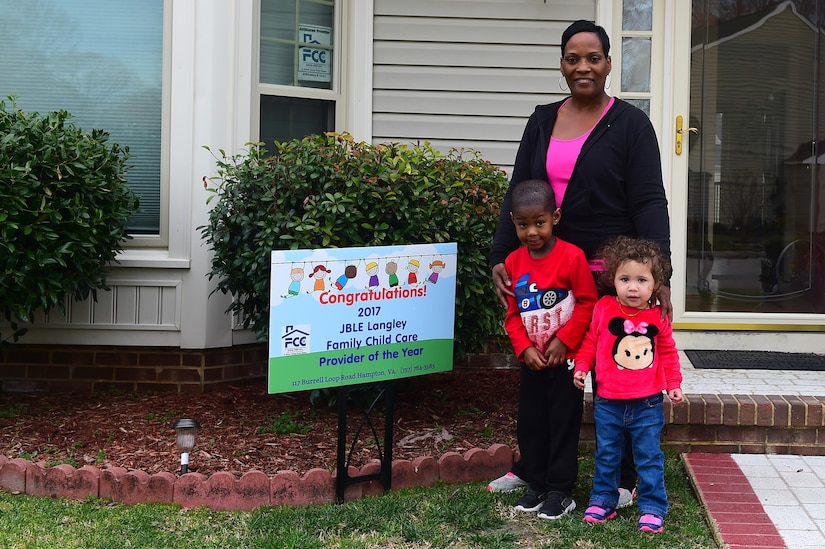 Cassandra Thomas, Child Development Center family child care provider, poses for a photo at her home in Hampton, Va., Feb. 28, 2017. Thomas was awarded the 2016 Provider of the Year for Langley Air Force Base. (U.S. Air Force photo/Senior Airman Derek Seifert)