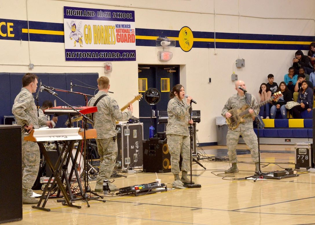 The U.S. Air Force Academy band Blue Steel performs a concert for students at Highland High School in Albuquerque. Blue Steel performs high energy music from a variety of genres, and its versatility and dynamic stage presence enables the band to help tell the Air Force story to audience members of all ages.