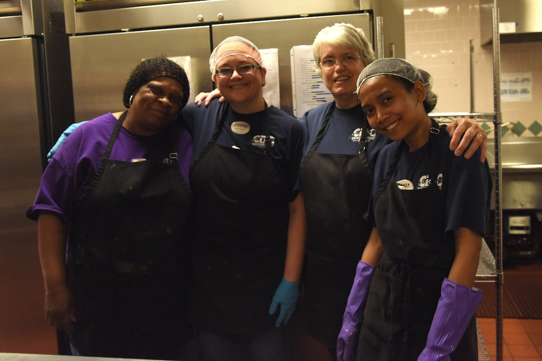 Child Development Center and Youth Center food service workers pose for a photo at the CDC April 24, 2017, at Malmstrom Air Force Base, Mont. The team provides breakfast, lunch and a snack to the CDC and breakfast and a snack to the kids at the Youth Center during the school year and when they are out of school. (U.S. Air Force photo/Senior Airman Jaeda Tookes)
