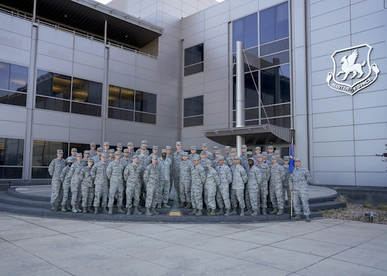 """The 1st Space Operations Squadron celebrates their reeipt of the General Richard C. Henry award with a group photo at Schriever Air Force Base, Colorado, Wednesday, April 26, 2017. 1 SOPS has a phrase they hold near and dear, especially after winning best space operations squadron of 2016, which is:  """"If you're not first, you're last."""" (U.S. Air Force photo/Christopher DeWitt)"""