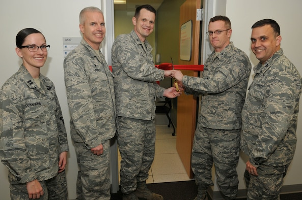 The 548th Intelligence, Surveillance, Reconnaissance Group leadership prepare to cut the ribbon for the opening of the Operational Health Unit at Beale Air Force Base, California Feb. 23, 2017. The mission of the unit is to take care of acute or new problems so Airmen can either get back to work quickly or get back home as soon as possible to recuperate. (U.S. Air Force photo/Senior Airman Ashley L. Gardner/ Released)