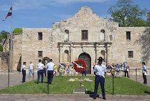 Service members place wreaths at the Alamo Monday during the Fiesta San Antonio Pilgrimage.