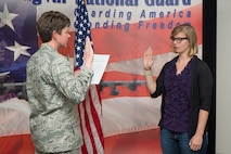 Alayna Stevenson recites the oath of enlistment, April 4, 2017 in Cheyenne, Wyoming. Stevenson's enlistment is a result from a home school event sponsored by the 153rd Recruiting and Retention office. (U.S. Air National Guard photo by Senior Master Sgt. Charles Delano/released)