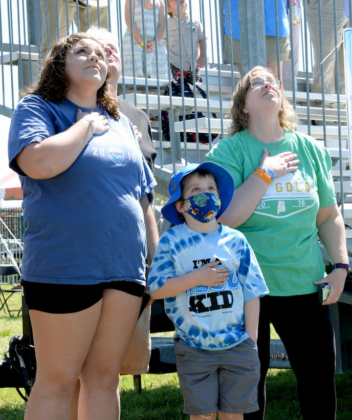 T.J. Esco, middle, and his family watch Air Force members parachute from an airplane during the Maxwell Air Show, April 9, 2017. Since being diagnosed with Acute Lymphoblastic Leukemia, T.J. would pretend to be a pilot and fly airplanes with his father during multiple hospital stays. (U.S. Air Force photo/Senior Airman Tammie Ramsouer)