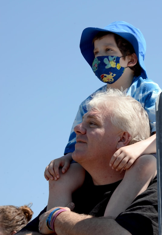 T.J. Esco, and his father, Tim Esco, watch acrobatic airplanes fly during the Maxwell Air Show, April 9, 2017. T.J. was diagnosed with Acute Lymphoblastic Leukemia in 2015, and has already had two full rounds of chemotherapy. He is currently in remission, but is continuing chemo medication for the next two years. (U.S. Air Force photo/Senior Airman Tammie Ramsouer)
