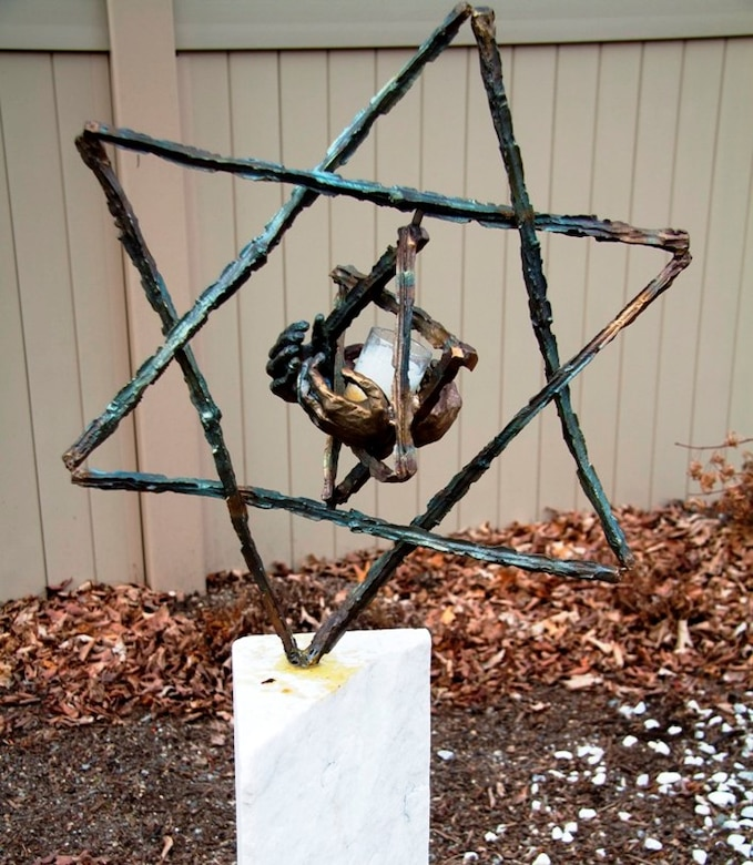 Fred Manasse, a survivor of the Holocaust, donated this sculpture he created to a cemetery in Milton, Massachusetts in 2012, where it was stolen in September 2016 and now is in the process of being replaced. The two Stars of David commemorate his sister and 1.5 million other child victims of the holocaust.  (Photo courtesy of Fred Manasse)