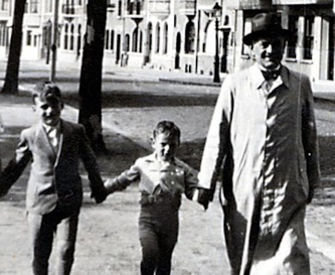 Fred Manasse, a Holocaust survivor, is flanked by his brother, Gus, and his father, Alfred, in Brussels December 1, 1939. Fred and his brother survived, but his father was killed in the Auschwitz concentration camp. Manasse relayed his experiences as part of the Holocaust Days of Remembrance at Hanscom Air Force Base, Massachusetts, April 24, 2017. (Photo courtesy of Fred Manasse)