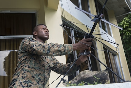 U.S. Marine Staff Sgt. Alexander Davis adjusts a satellite communication antenna during Balikatan 2017 at Camp Lapulapu, Cebu, April 25, 2017. Balikatan is an annual U.S.-Philippine military bilateral exercise focused on a variety of missions, including humanitarian assistance and disaster relief, and counterterrorism.
