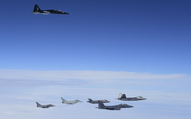 A 71st Fighter Training Squadron T-38 Talon flies above U.S. Air Force, French air force and Royal air force planes during ATLANTIC TRIDENT 17 near Joint Base Langley-Eustis, Va., April 26, 2017. The U.S. Air Force F-15E Strike Eagles and T-38 Talons played the roles of adversary aircraft during the exercise, testing the coalition team's capabilities. (U.S. Air Force photo/Staff Sgt. Natasha Stannard)
